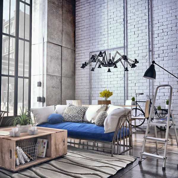 Painted brick and scored concrete walls create an interesting visual dynamic in this bright home. These distinctive surface treatments lend themselves to a softer look when paired together, far more comforting than either wall treatment could be on its own. The eclectic furniture and decor certainly help to enliven and energize the whole room.