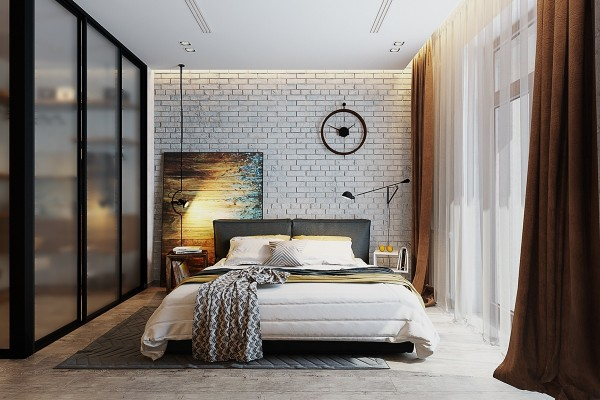Here, the accent wall is a little simpler in terms of concept, and more accessible to those who prefer a classic decor style. The brick accent wall is painted in white but retains plenty of characteristic texture. The painting to the left serves as a sort of implied headboard. The overall look embraces a rugged, chic, and tasteful personality.