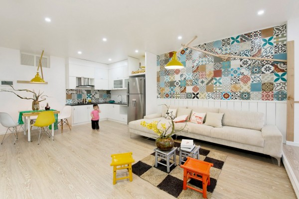 Bright furniture and fixtures make an immediate impression, even managing to stand out against the exciting ceramic tiles in the background. A very imaginative style!