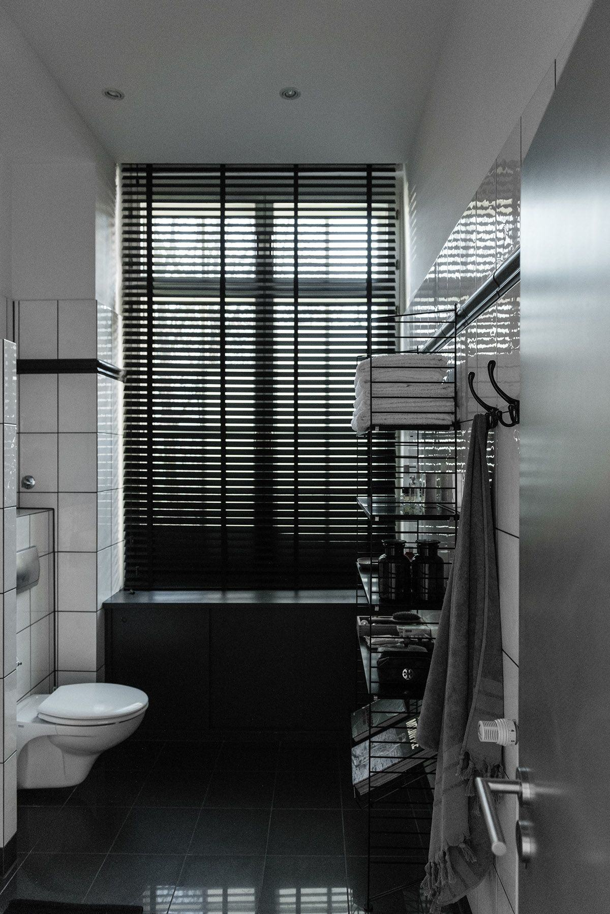 Grayscale Bathroom Inspiration - Stylish exposed brick wall lofts