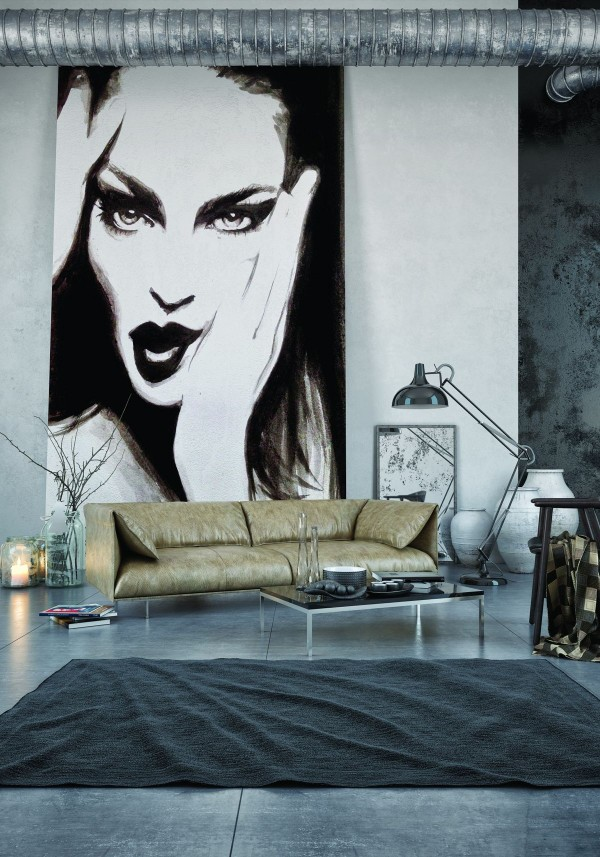 """Making fantastic use of both light and dark concrete, this home offers an inspirational look at the flexibility of concrete as a finished surface. With such tall ceilings, the darker colors get rid of that """"empty"""" feeling and make the home feel more intimate and comfortable. The floor-to-ceiling painting draws the eye immediately – and the lighter concrete makes a wonderful backdrop."""