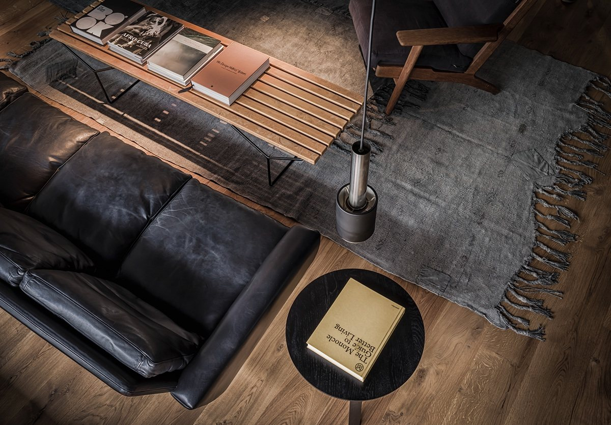 Leather And Wood Living Room Decor - 4 beautiful dark themed homes
