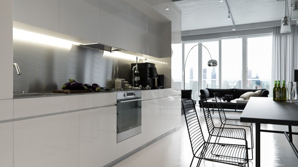 The kitchen unit continues the streamlined theme with elegant handle-free design and a sleek stainless steel backsplash.