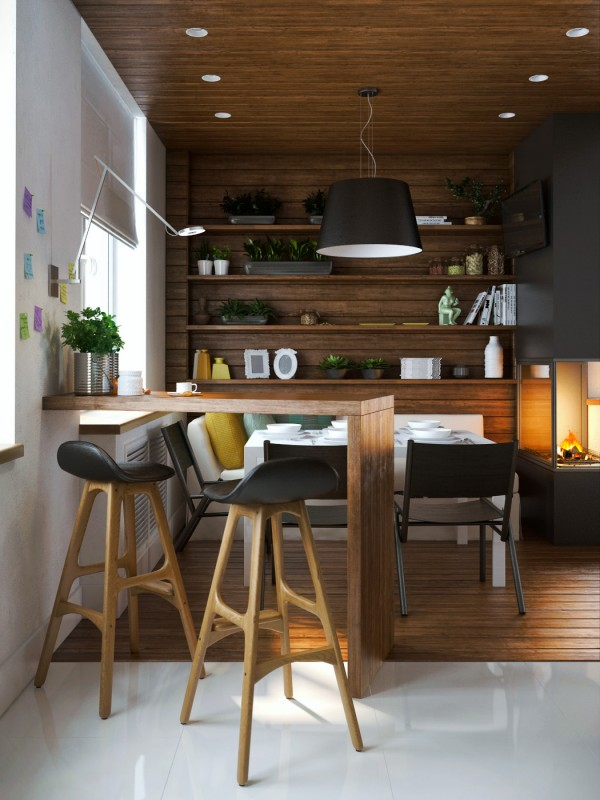 Rich, dark woods offer a relaxing and warm atmosphere in the dining room. And get this – there's even a sofa in place of a bench seat on the far side. The sleek Danish breakfast stools by Erik Buch are undeniably inviting as well.