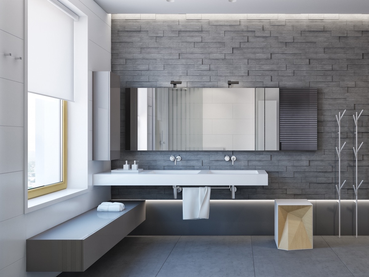 Gray Stone Bathroom Walls - Two apartments with sleek grayscale interiors