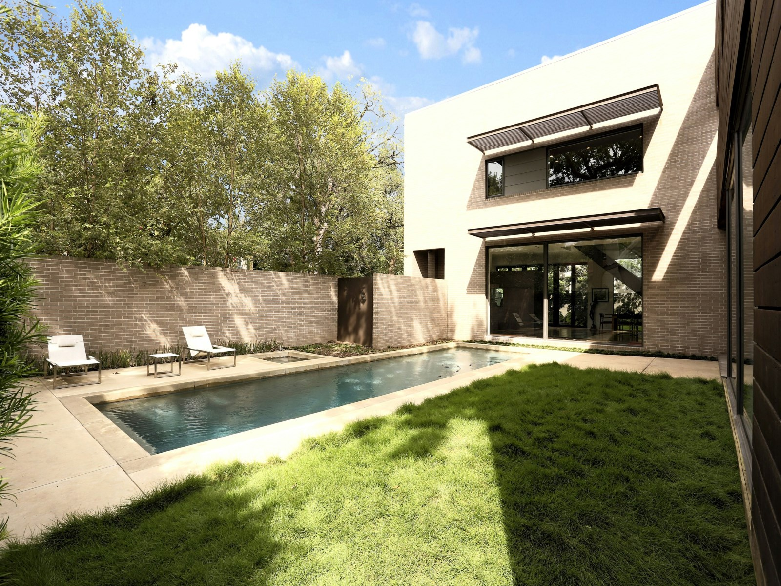 Backyard Pool Inspiration - A home with formidable architecture and a light interior