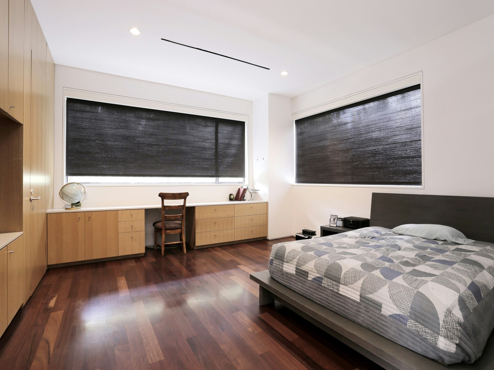 Bedroom Privacy Shades - A home with formidable architecture and a light interior