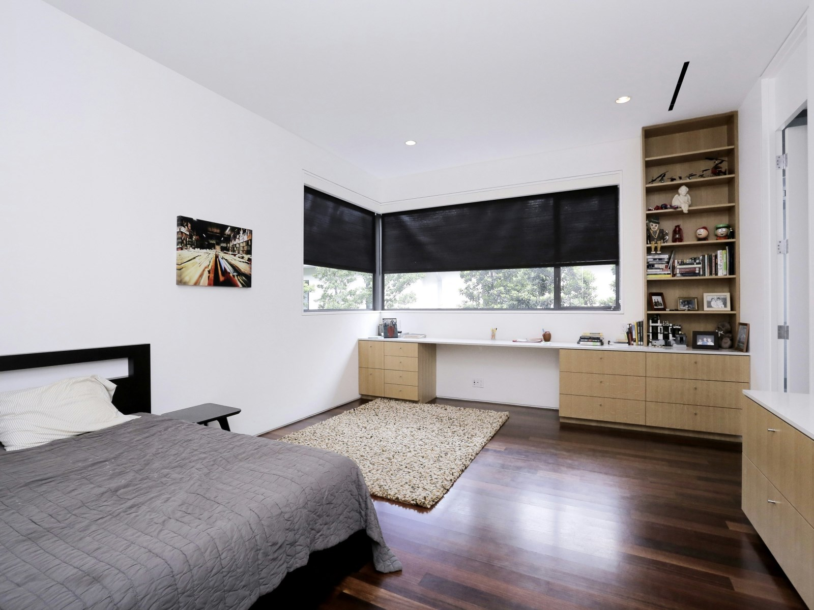 Bedroom With Corner Window - A home with formidable architecture and a light interior