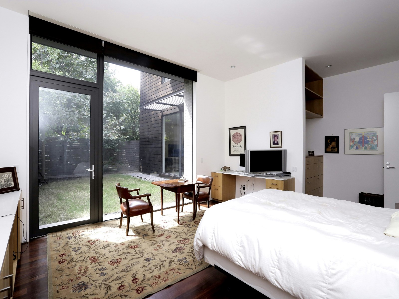 Comfortable Guest Bedroom Ideas - A home with formidable architecture and a light interior