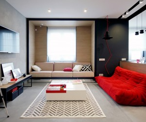 First, let's look at a home that packs tremendous character into a modest yet versatile 56 square meters. Nika Vorotyntseva designed this apartment for a young woman who lives in the city. Energetic red accents ensure the home's unique personality speaks out through every detail. The color theme is mostly uniform all the way across, with just a few dashes of secondary accents employed in surprising places. Red is a rare interior theme because it's difficult to work with, but this apartment makes it look like a breeze.