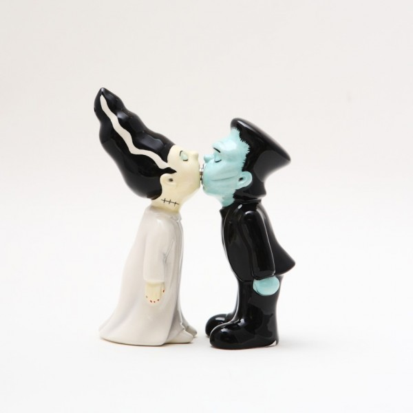 Halloween enthusiast? Classic horror fan? Dr. Frankenstein's Monster and his Bride lock lips in this charmingly romantic pair of spice dispensers.