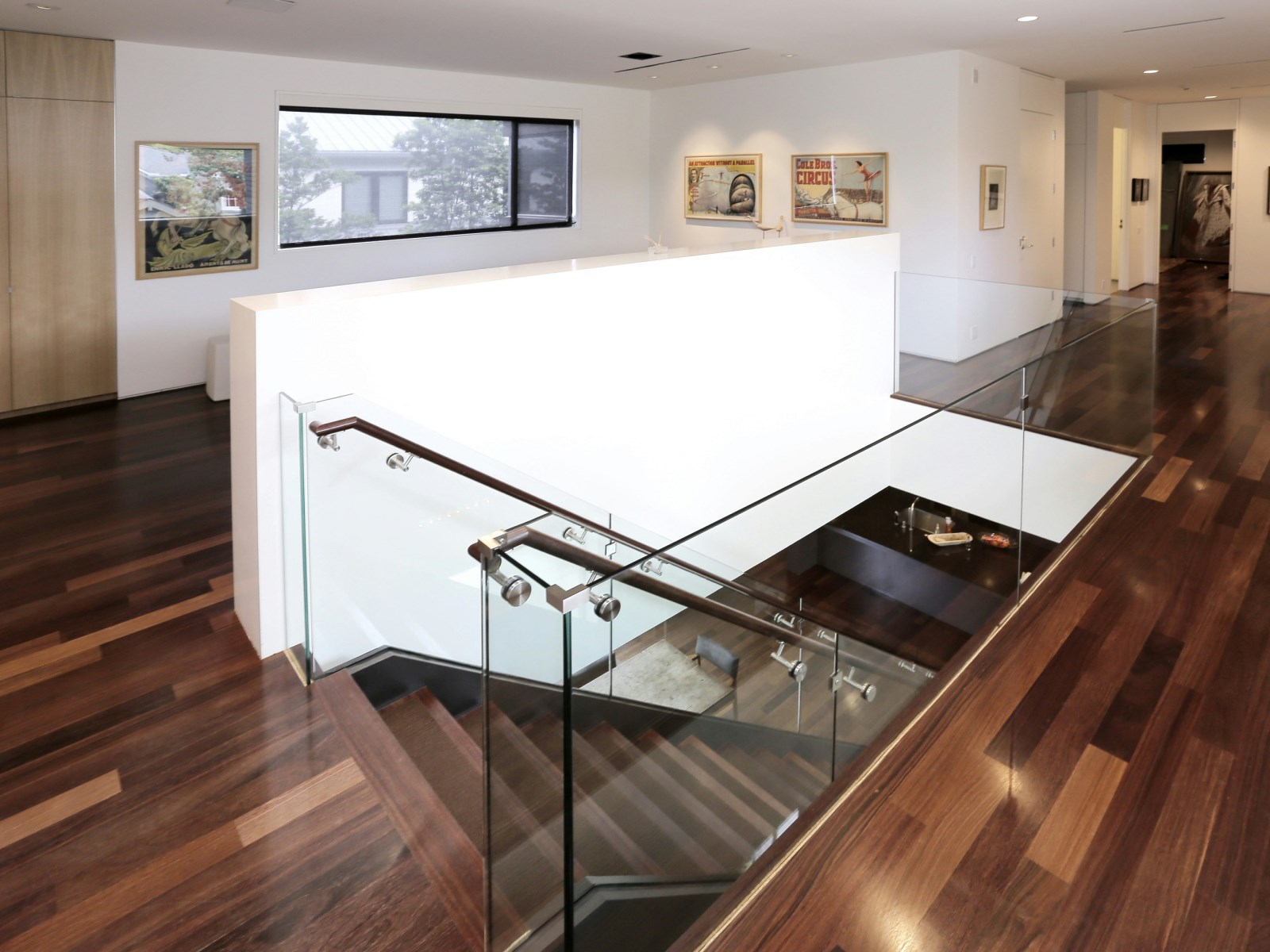 Glass Staircase Handrail Idea - A home with formidable architecture and a light interior