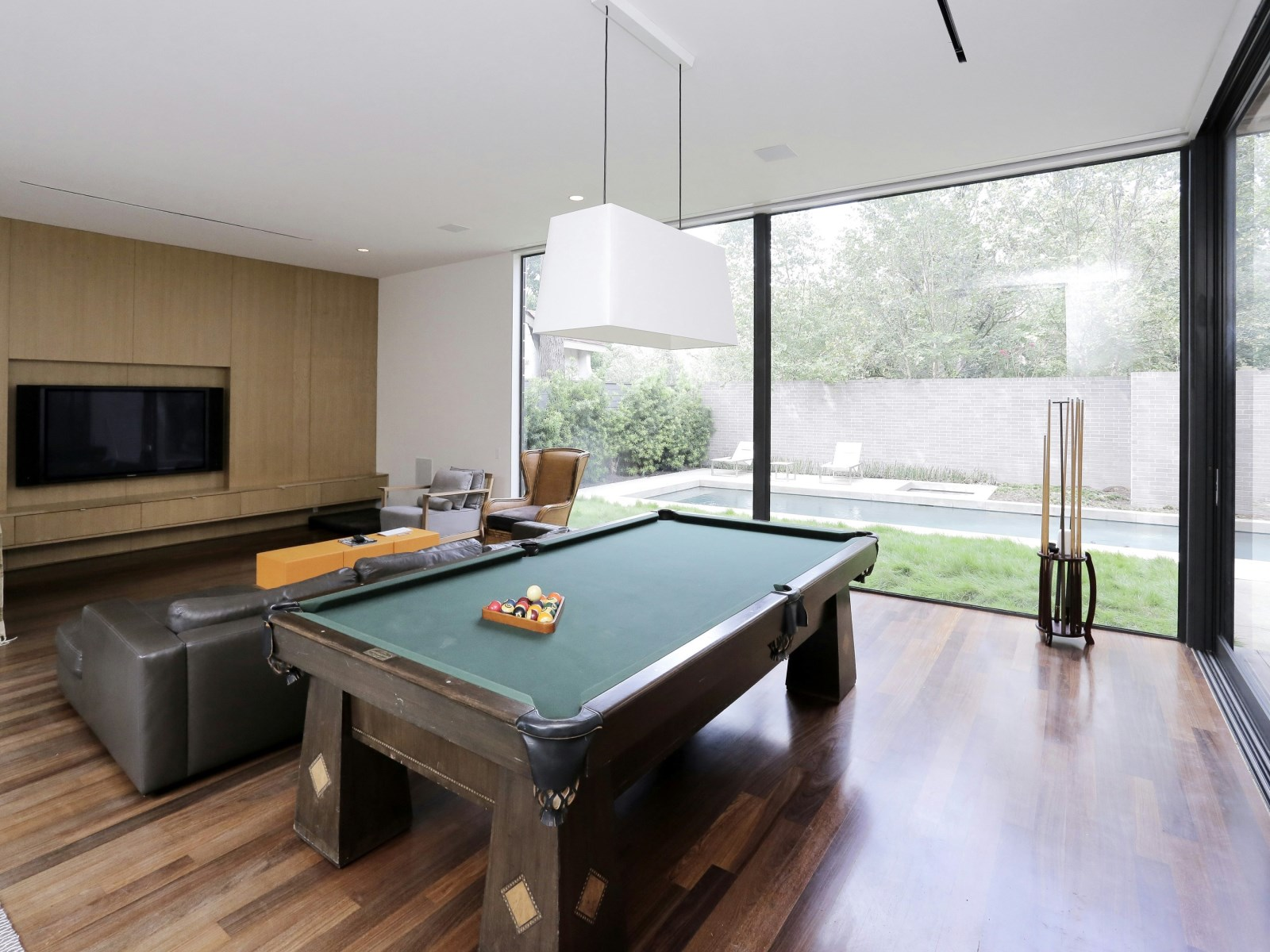 Home Game Room Inspiration - A home with formidable architecture and a light interior