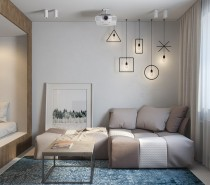 This first apartment occupies a compact studio in St. Petersburg, working with only 29 square meters of floor space. It was designed with a young woman in mind, who desired the freedom of a studio layout with the privacy of a divided home.