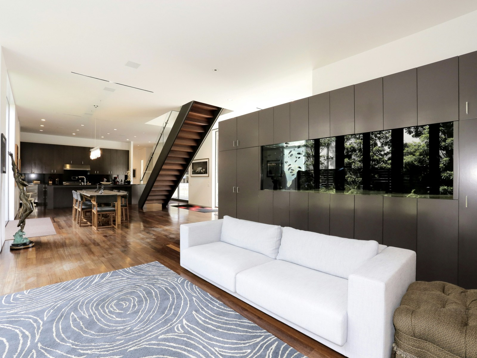 Living Room Aquarium Inspiration - A home with formidable architecture and a light interior