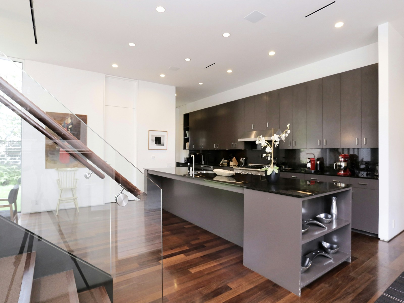 Luxury Grayscale Kitchen - A home with formidable architecture and a light interior