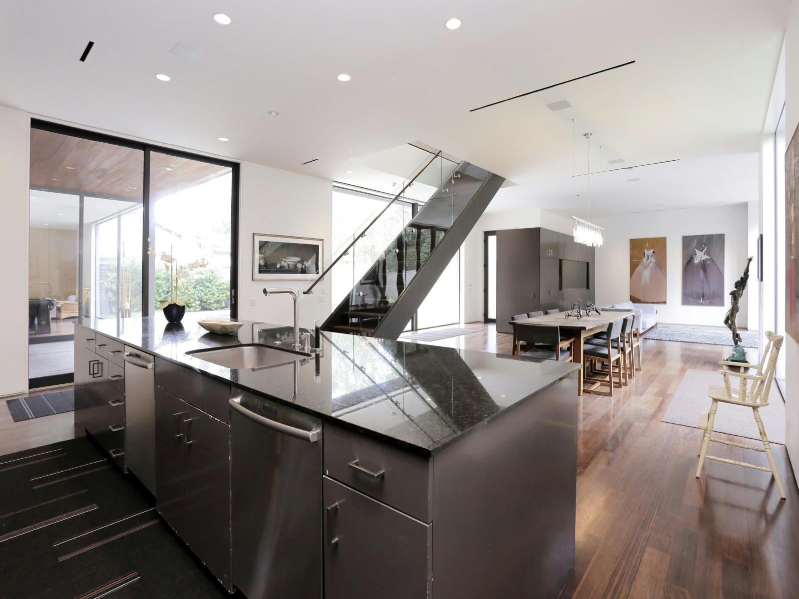 Mixing Glossy And Matte In The Kitchen - A home with formidable architecture and a light interior