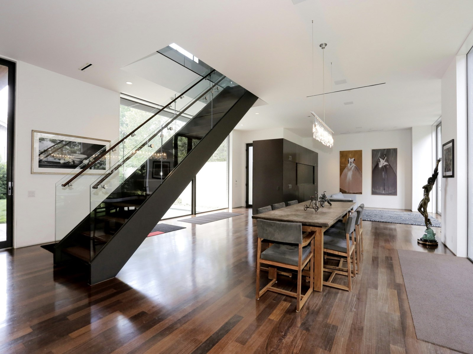 Modern Central Staircase - A home with formidable architecture and a light interior