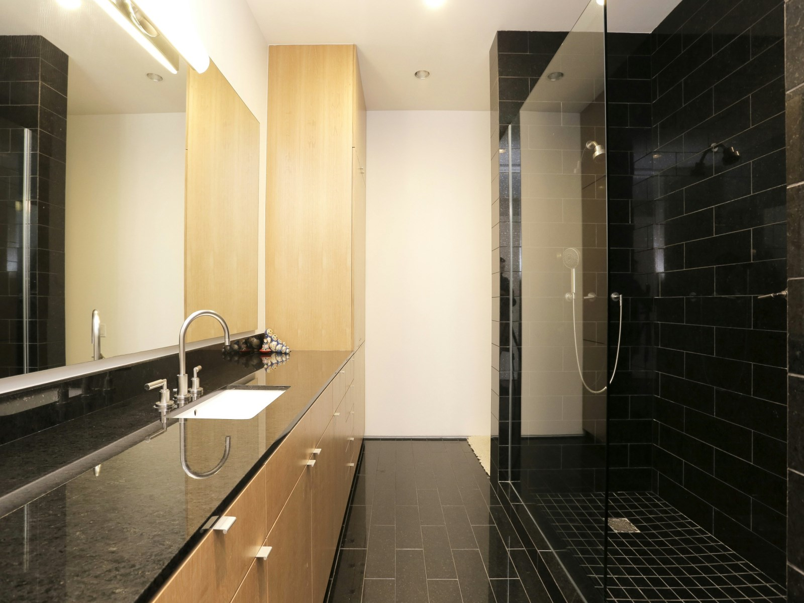 Modern Granite Bathroom - A home with formidable architecture and a light interior