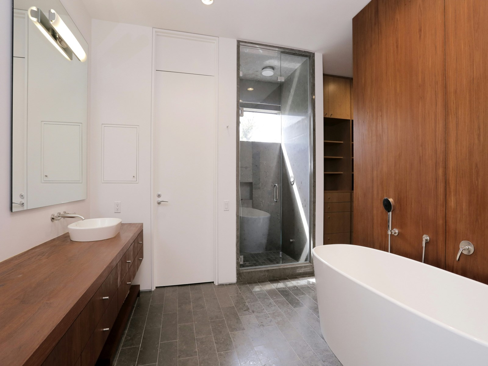 Relaxing Teak Bathroom - A home with formidable architecture and a light interior