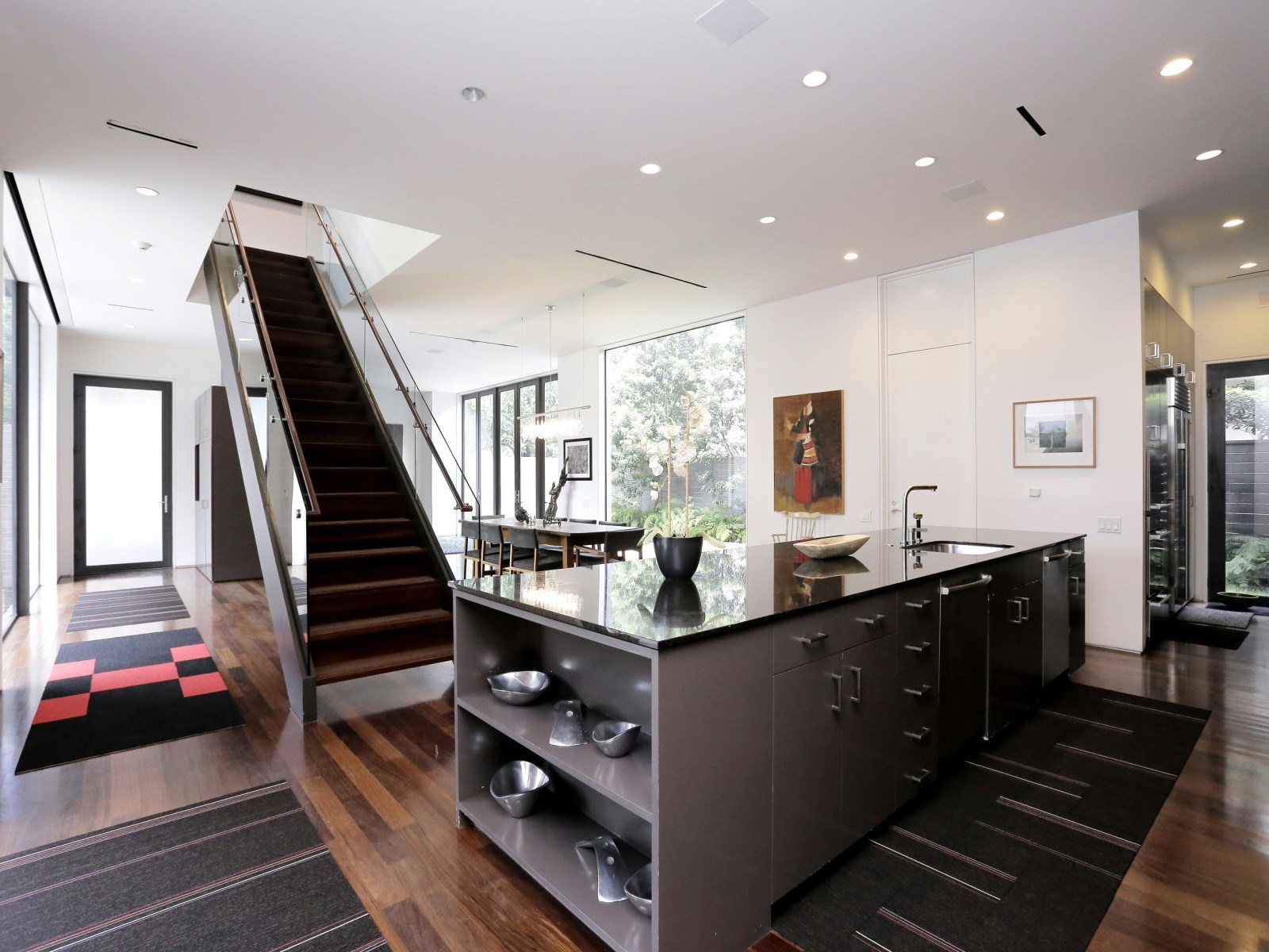 Silver And Black Kitchen - A home with formidable architecture and a light interior