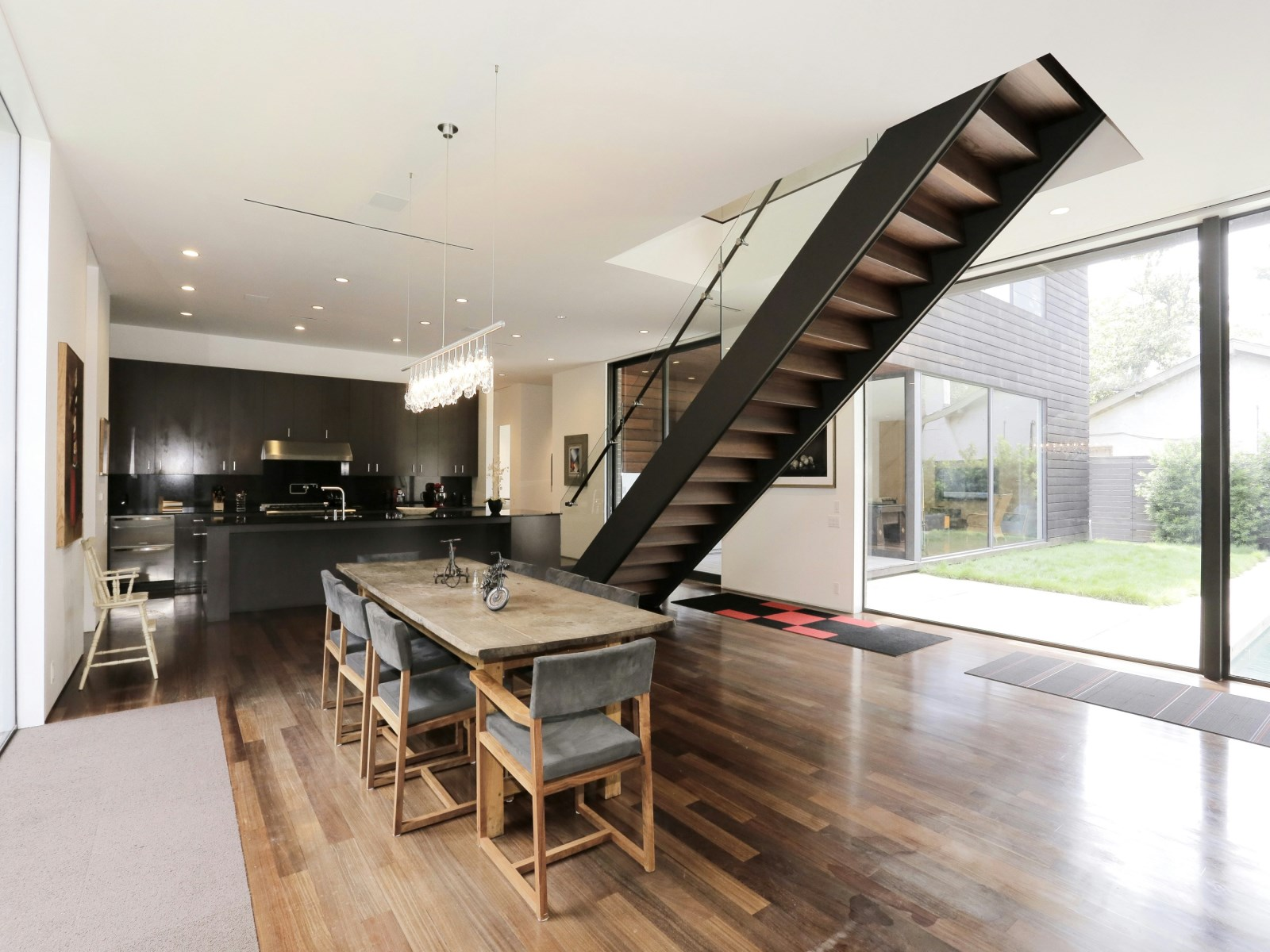 Staircase Inspiration - A home with formidable architecture and a light interior