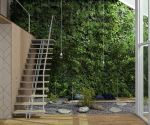 A lush vertical garden reaches to the heights of the atrium and is easy to appreciate from the mezzanine level above. Note the small wood platform in the middle of the rock garden – certainly a wonderful place to read or meditate.