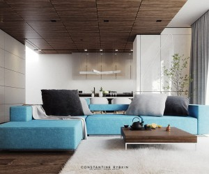 This home design in Lugano, Switzerland, offers a cheerful approach to a minimalistic and natural interior. The bright blue sofa with oversized gray pillows definitely makes a bold first impression. It's the only non-neutral piece used throughout the entire living room, yet this block of color more than invigorates the room.