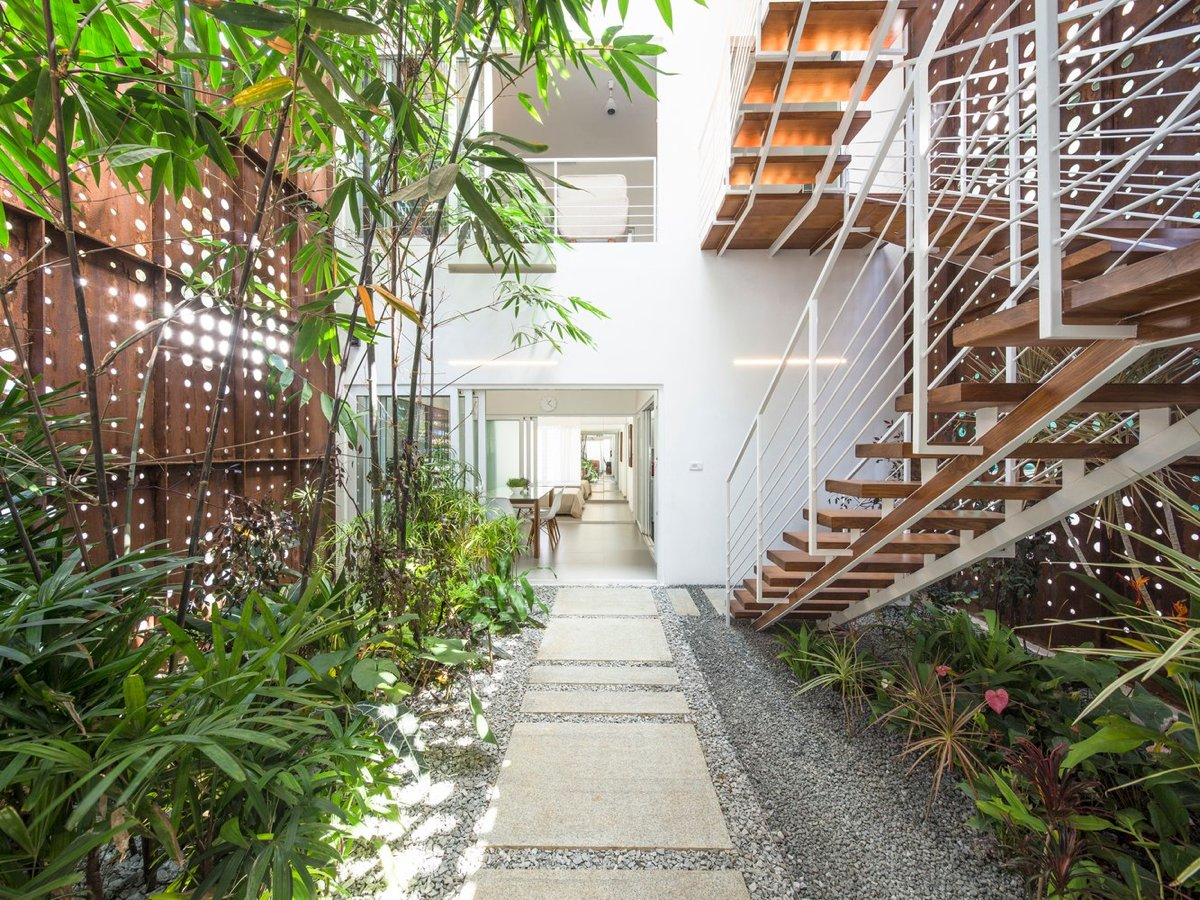 A Gorgeous Home Split By Covered Garden Atrium
