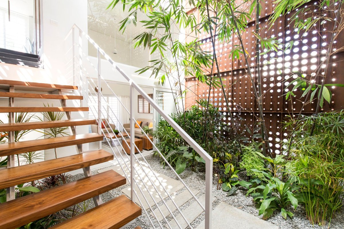 A gorgeous home split by a covered garden atrium What is an atrium in a house