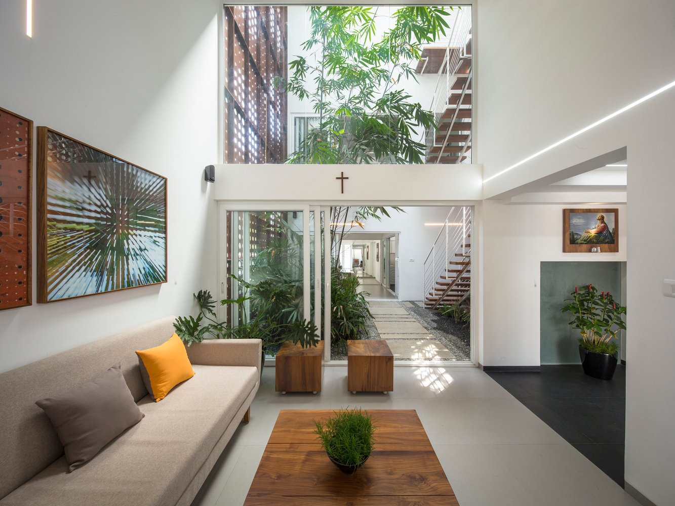 A gorgeous home split by a covered garden atrium for Atrium homes