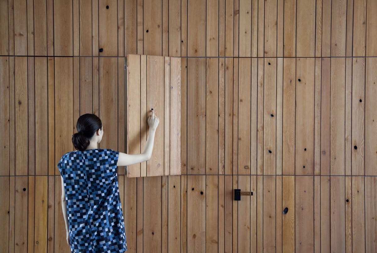 Knotty Wood Interior Cabinets - An incredible interior courtyard shielded by optical glass bricks