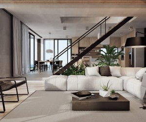 The interior maximizes its exposure to the gorgeous landscape with an open floor plan for the social areas, the kitchen and living room divided by a dramatic central staircase that ascends through a rectangular void in the concrete ceiling.