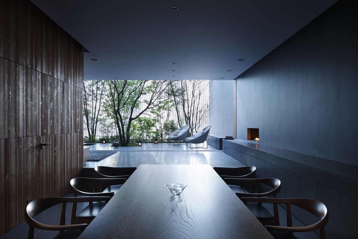 Modern Natural Dining Room - An incredible interior courtyard shielded by optical glass bricks