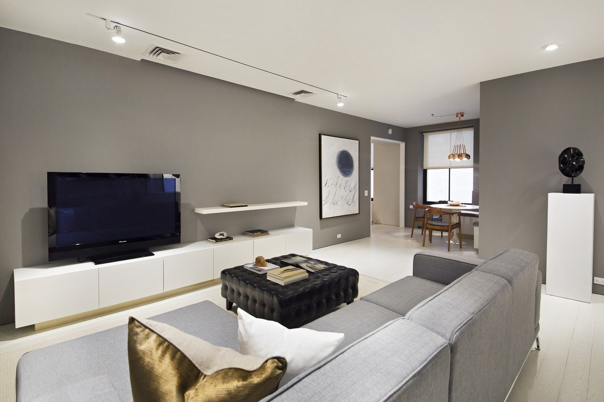 The media room remains simple but continues the trend of metallic accents. This layout is practical and feels laid back yet every detail stands out.