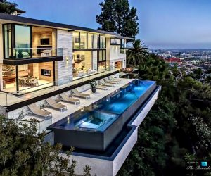Tucked in the Hollywood hills, this incredible property takes advantage of it's hillside position to maximize views from the home and that infinity pool.
