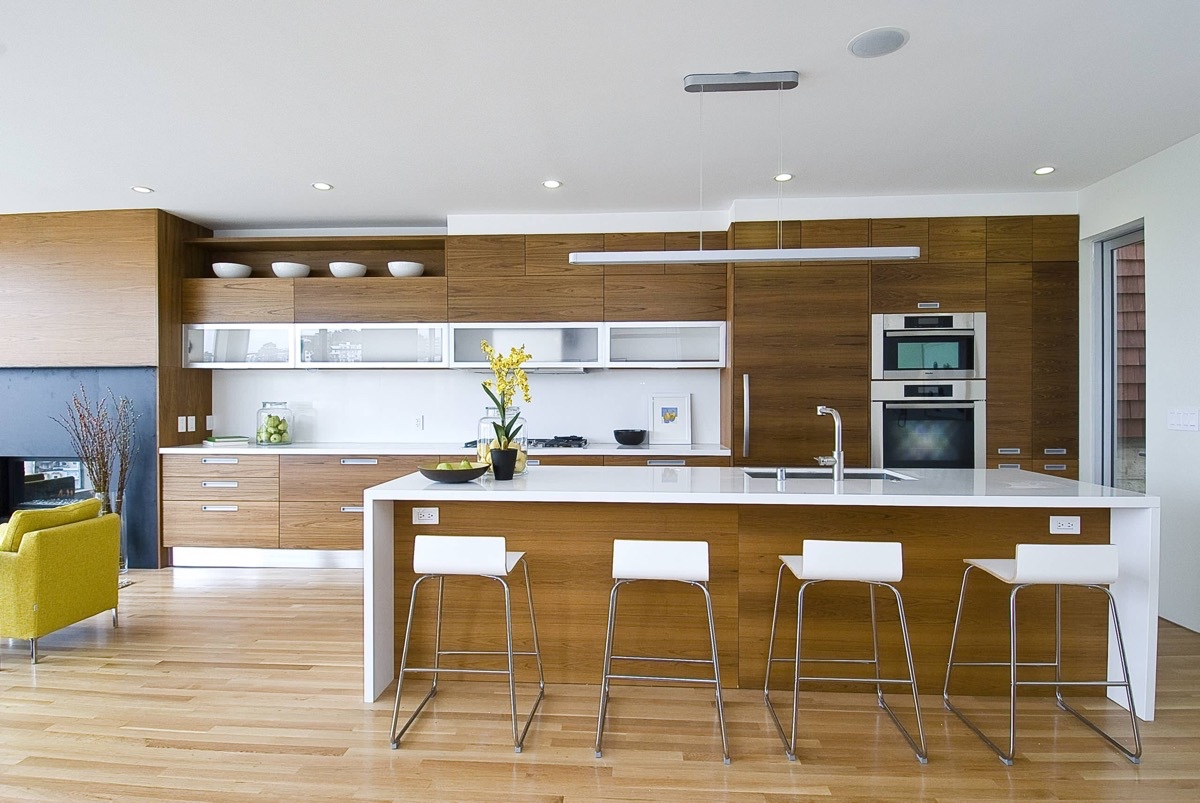50 unique kitchen pendant lights you can buy right now for Modern teak kitchen cabinets