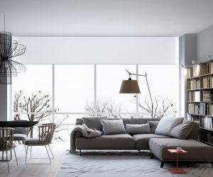 Finally, a look at the last home – this one has the most reserved color strategy of them all. The living room basks in its relaxing greyscale color palette, with the only dash of color coming from an unassuming side table near the sofa. This interior proves that even the most utilitarian object can fill an important aesthetic role.