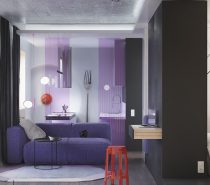 This small apartment definitely doesn't shy away from the adventure of a bold decor theme. Violet, lavender, and bright fire engine red define the interior – thanks to careful decorating techniques. Bright colors are difficult to work into a constricted space. So even if you don't personally love the colors, the composition techniques are still worth studying.