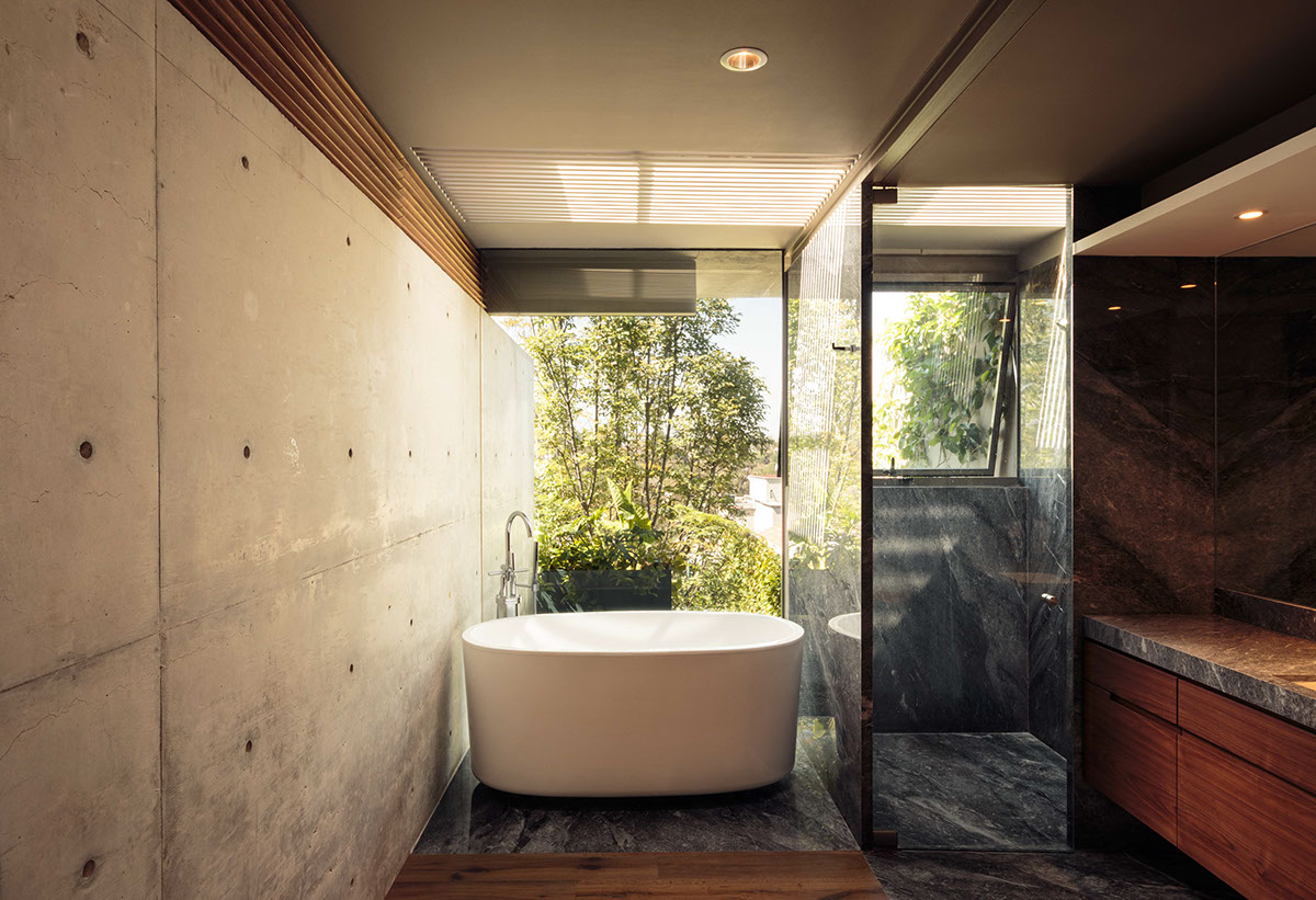 Concrete Glass And Wood Bathroom - An atmospheric approach to modernist architecture in mexico
