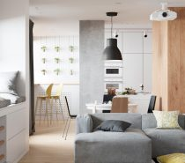 Throughout this gorgeous home the main colors used are gray, yellow, white, and black. Occasionally in the children's rooms other colors will be utilized. In this photo, you can see the wall art in the kitchen. Potted plants hang in lines and give the space another color, green!