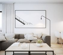 This home is located in Krakow proper. Its modern high-contrast interior adopts a much stricter aesthetic, almost minimalist in its focus. Black and white make up the foundation of the color scheme but middling greys and browns help to soften the look.