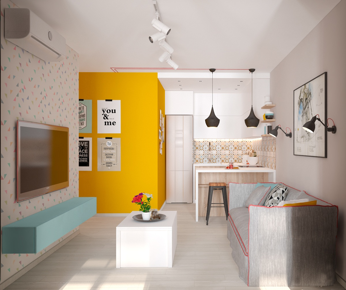 This small apartment in Kiev is a perfect starter. Opening the door on a bold mustard wall, confetti wallpaper greets the eye on pale teak floors. A focal point of interest in two black hanging lights offers promises in the larger space beyond.
