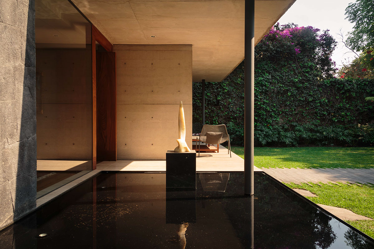 Stone Sculpture In Black Pool - An atmospheric approach to modernist architecture in mexico