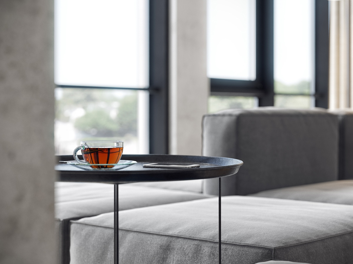 Tea On Black Side Table Grey Couch - 3 white themed homes with striking modern minimalist aesthetics