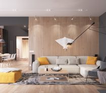 Beginning the tour with the living room, visitors are immediately greeted by bright yellow accents against a backdrop of neutral grey and light-toned wood cladding. The wood floors are certainly a hallmark of Scandinavian design, but other features break the mold and enter into unique territory – like the plaster manta ray hanging on the wall.