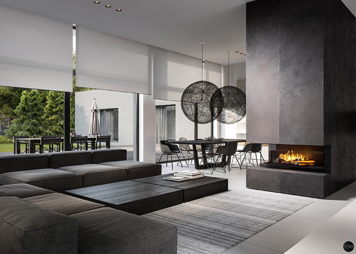 Woven orbs hang in the dining area and continue through to the fireplace. Within a high vertical iron shaft, a burst of orange flames adds cosiness to the scene. Green touches outside add a touch of nature, bordering the rooms' flat monochromatic furniture.