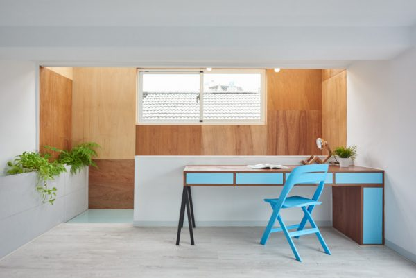 A spark of colour with a bright, turquoise desk breaks the simplicity of the interior, afforded by the concrete flooring and toned-down wall colouring. Cute elements such as ceramic doves insert a Taiwanese quirk into random spaces.