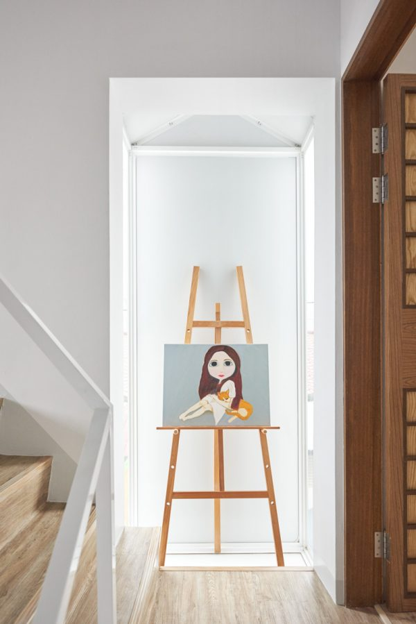 A pop of Taiwanese art finds itself on easels in enclaves and larger-than-life stones on grey wooden floors.