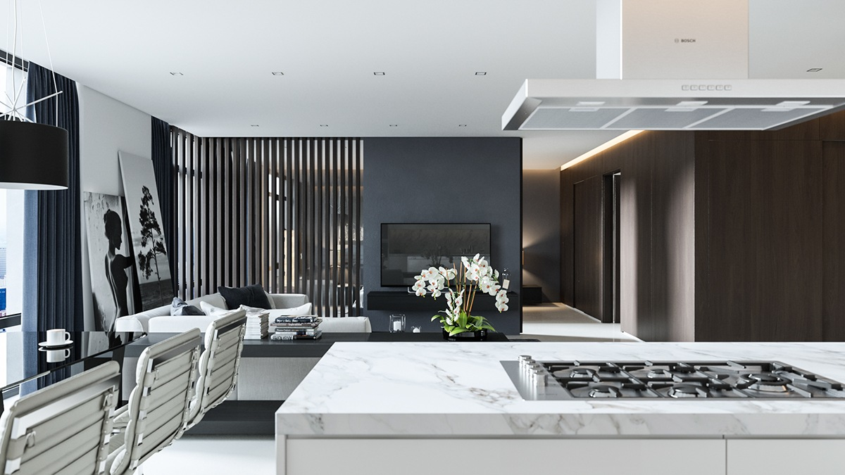 The white kitchen adds relief, while the marbled splashback continues the monochromatic theme. Looking to the black wooden slat partitions, light is let in.